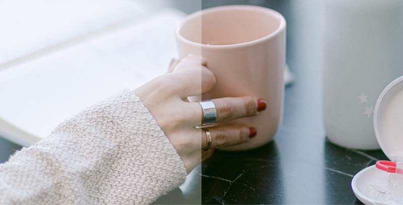 woman's hand is holding a coffee cup
